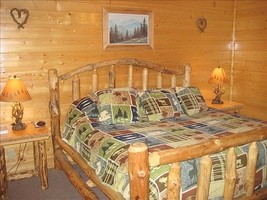 Cabin Master Suite features a king-sized bed, TV and bathroom